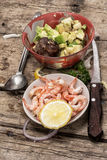 Preparation of salad with prawns Royalty Free Stock Photos