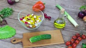 Preparation of salad  on wooden desk, stop motion animation. 4K stock footage