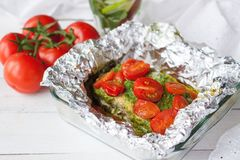 Preparation of salmon with pesto, tomatoes, asparagus Stock Photography