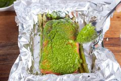 Preparation of salmon with pesto, tomatoes, asparagus Royalty Free Stock Photography