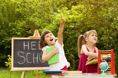Preparation for school in nature. two little girls playing in sc Royalty Free Stock Photo