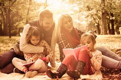 Preparation for school. Happy family in park royalty free stock image