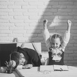 Preparation for school. Schoolgirl with positive emotions and her sleeping tutor Stock Image