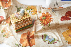 Preparation and selection of fabrics for sewing patchwork quilt. On an electric sewing machine Stock Image
