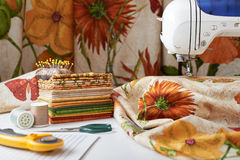 Preparation and selection of fabrics for sewing patchwork quilt. On an electric sewing machine Royalty Free Stock Photos