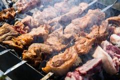 Preparation of shish kebab on skewers Royalty Free Stock Photo