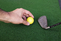 Preparation for Shooting a Golf Ball. On a Training Area Stock Photo