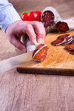 Preparation of smoked meat delicatessen Royalty Free Stock Photography