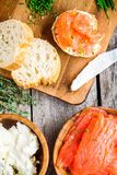Preparation smoked salmon sandwiches closeup Royalty Free Stock Images