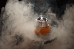 Preparation for Smoking fruit orange aroma hookah. Royalty Free Stock Image
