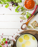 Preparation of soup at home. Rustic white background with vegetables and ingredients around the perimeter. Stock Photography