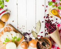 Preparation of soup at home. Rustic white background with vegetables and ingredients around the perimeter. Royalty Free Stock Photo