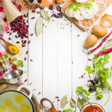 Preparation of soup at home. Rustic white background with vegetables and ingredients around the perimeter. Stock Photos