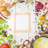 Preparation of soup at home. Rustic white background with vegetables and ingredients around the perimeter. Royalty Free Stock Images