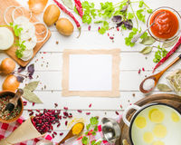 Preparation of soup at home. Rustic white background with vegetables and ingredients around the perimeter. Stock Images