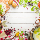 Preparation of soup at home. Rustic white background with vegetables and ingredients around the perimeter. Stock Image