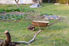 Preparation for spring work, wheelbarrow in yard Royalty Free Stock Photo