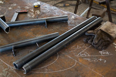 Preparation of steel assemblies on table Stock Images