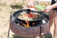 Preparation step of authentic Paella Valenciana Stock Images