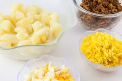 Preparation steps of traditional Colombian dish called stuffed potatoes. Cooked ingredients to prepare Colombian stuffed potatoes royalty free stock images