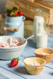 Preparation of strawberry ice cream in a wafer Royalty Free Stock Photo