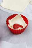 Preparation of strawberry muffins Royalty Free Stock Photo