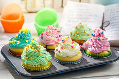 Preparation for sweet cupcakes with cream and decoration Stock Image