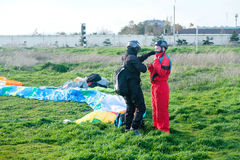 Preparation of tandem paraglider for the first flight Stock Photography