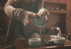 Preparation for tea ceremony. Woman making traditional chinese drink stock photos