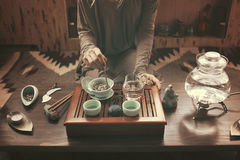 Preparation for tea ceremony. Woman making traditional chinese drink stock image