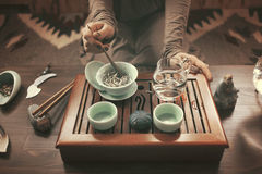 Preparation for tea ceremony. Woman making traditional chinese drink Royalty Free Stock Photo