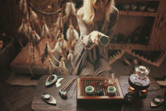 Preparation for tea ceremony. Young beautiful blonde woman at home making tea ceremony royalty free stock photos