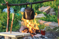 Preparation of tea coffee at the stake. royalty free stock images
