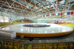 Preparation to race on ice in sports complex Stock Images
