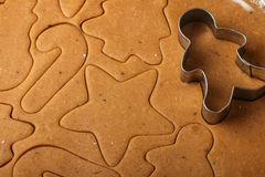 Preparation of a traditional gingerbread. Christmas. New year. The dough and cutting the cookie on the table Stock Photo
