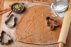 Preparation of a traditional gingerbread. Christmas. New year. The dough and cutting the cookie on the table Stock Image