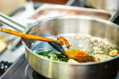 Cooking class. Preparation of traditional Sri Lankan curry dish at cooking class Royalty Free Stock Photos