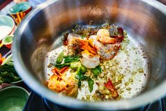 Cooking class. Preparation of traditional Sri Lankan curry dish with shrimps at cooking class Stock Photo