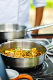 Cooking class. Preparation of traditional Sri Lankan curry dish with tender chicken breast at cooking class Royalty Free Stock Image