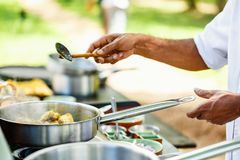 Cooking class. Preparation of traditional Sri Lankan curry dish with tender chicken breast at cooking class Royalty Free Stock Photos