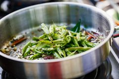 Cooking class. Preparation of traditional Sri Lankan dish with green beans at cooking class Stock Photos