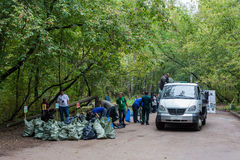 Preparation of trash bags to be loaded on truck. MOSCOW - SEP 15: Preparation of trash bags to be loaded on truck in Elk Island National Park on National royalty free stock image