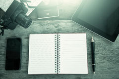 Preparation for travel, opened notebook,pen,cellphone,tablet Royalty Free Stock Images
