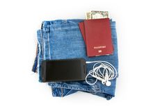 Preparation for travel, passport, money, telephone with headphones on jeans isolated white background stock photos