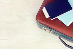 Preparation for travel. Retro suitcase with documents of top view Stock Photography