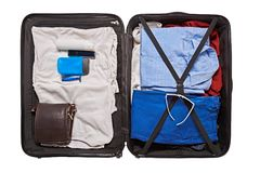Preparation for travel. Top view of male clothes and accessories for travel in valise Royalty Free Stock Photography