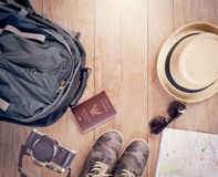 Accessories for travel concept. Preparation for travel,trip vacation, tourism mock up of road map,ccamera,shoes,sunglasses ,passport Backpack ,on wooden table royalty free stock photos