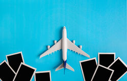 Preparation for Traveling concept, Airplane with Photo frame. Stock Photo