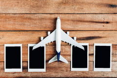Preparation for Traveling concept , Airplane with photo frame. Stock Photo