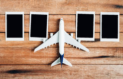Preparation for Traveling concept , Airplane with photo frame. Stock Photography